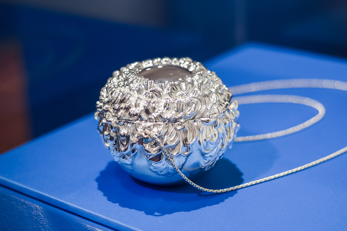 Photo of artist Michael Galmer's 'Evening Glory Purse' silver sculpture at Biggs Museum.