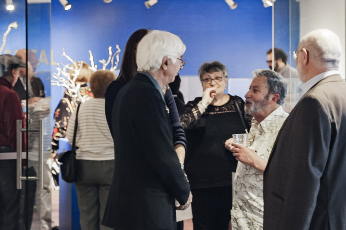 Photo of silver sculptor Michael Galmer at the opening reception 'Monumental' at Biggs Museum.