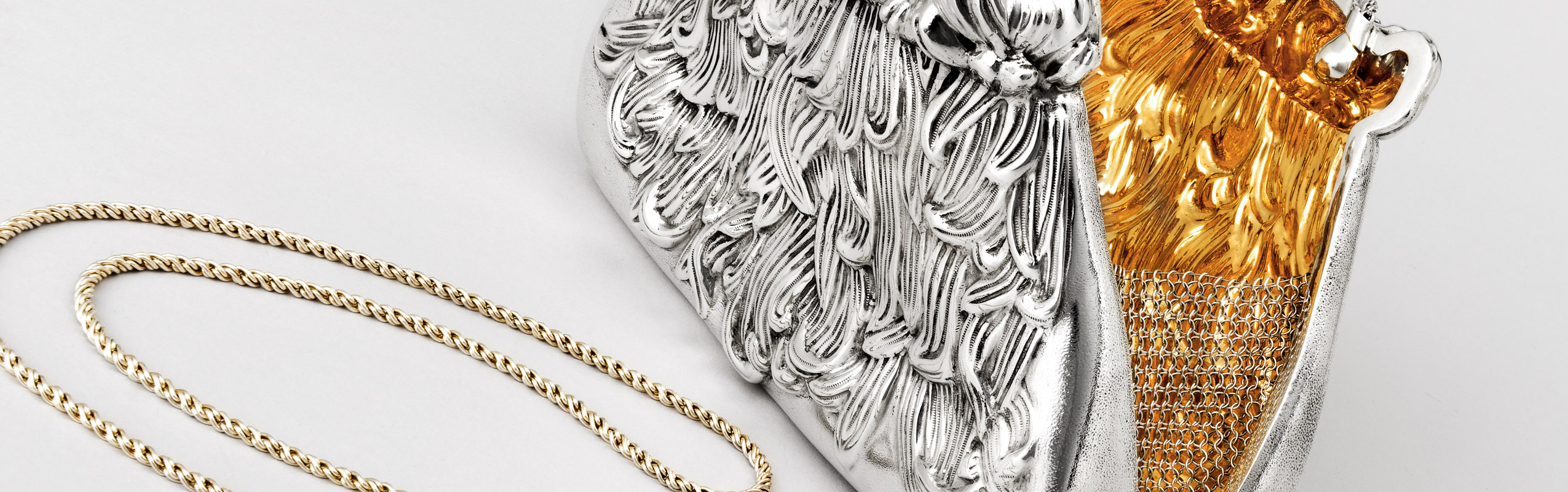 Photo of a sterling silver and 24K gold evening purse  by Michael Galmer.