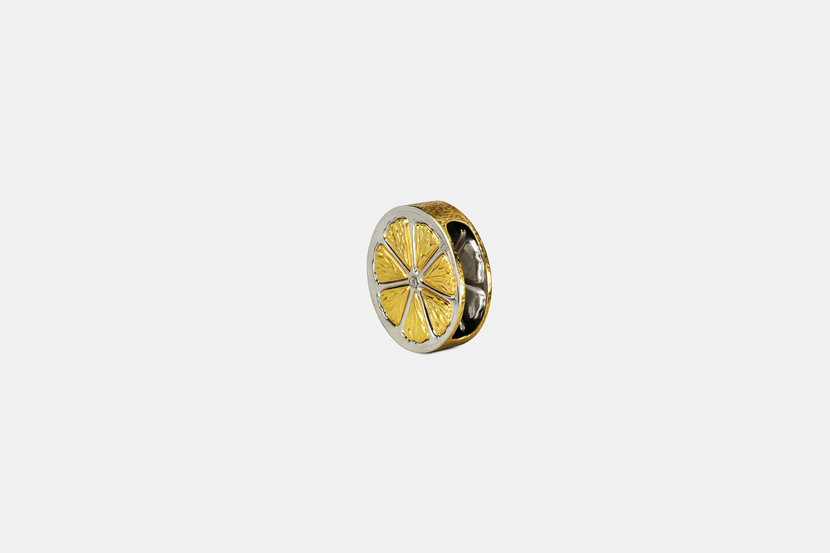 Michael Galmer's sterling silver and 24K gold plated 'Lemon Napkin Ring'.