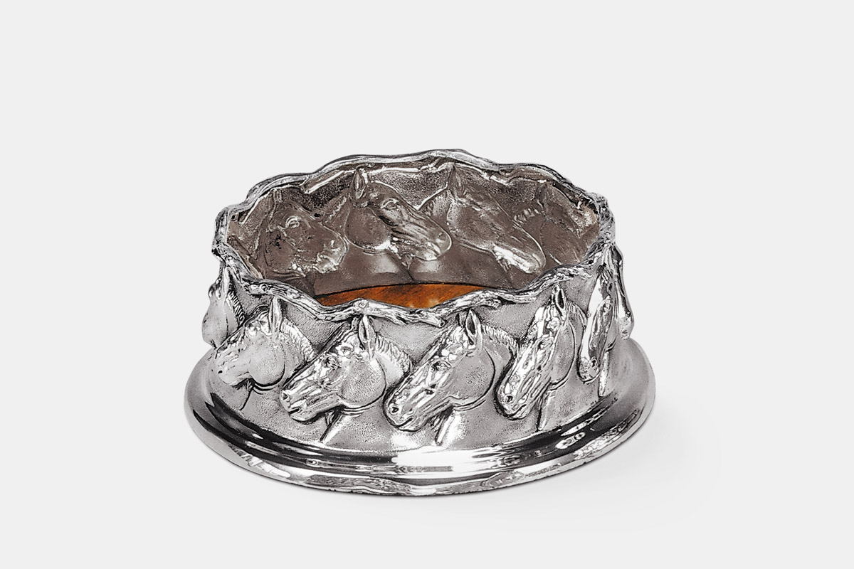 Michael Galmer's sterling silver and 24K gold 'Horses Wine Coaster'.